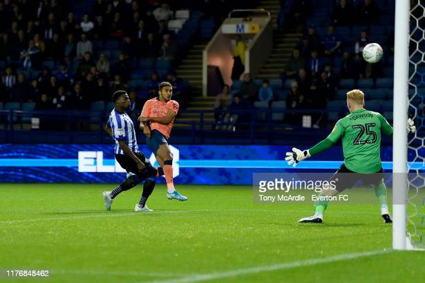 Dominic CalvertLewin of Everton shoots to score his first goal during the Carabao Cup Third Round match between Sheffield Wednesday and Everton at...