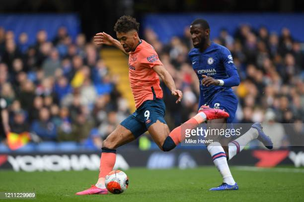 Dominic CalvertLewin of Everton shoots under pressure from Antonio Rudiger of Chelsea during the Premier League match between Chelsea FC and Everton...
