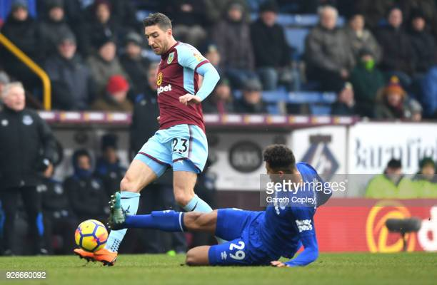 Dominic CalvertLewin of Everton tackles Stephen Ward of Burnley during the Premier League match between Burnley and Everton at Turf Moor on March 3...