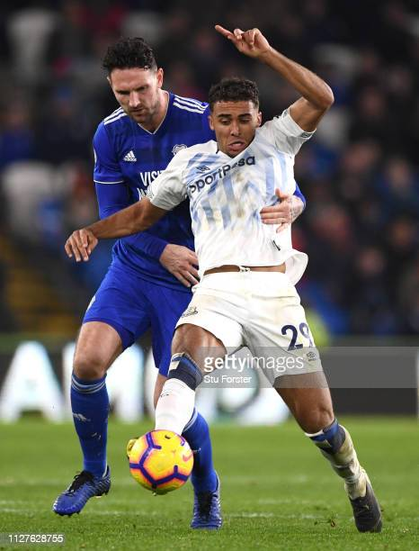 Dominic CalvertLewin of Everton tangles with Sean Morrison of Cardiff City during the Premier League match between Cardiff City and Everton FC at...