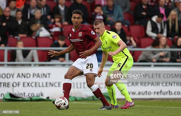 Dominic Calvert-Lewin of Northampton Town looks to play the ball watched by Scott Harrison of Hartlepool United during the Sky Bet League Two match...