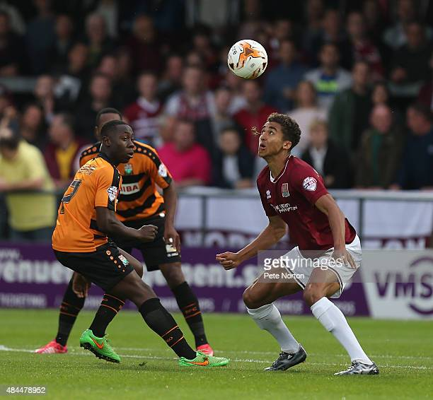 Dominic CalvertLewin of Northampton Town looks to the ball with Andy Yiadom of Barnet during the Sky Bet League Two match between Barnet and...