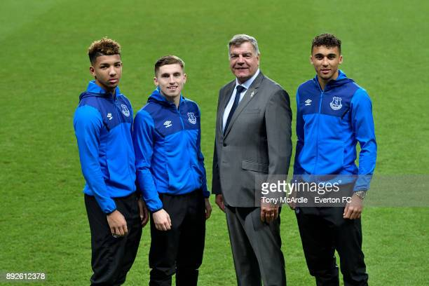 Dominic CalvertLewin poses for a photo with team mates Jonjoe Kenny Mason Holgate and manager Sam Allardyceafter signing a new Everton contract at...