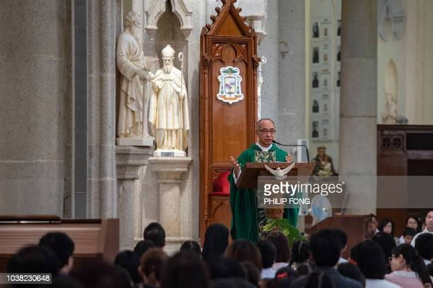 Dominic Chan the Vicar General of the Hong Kong Catholic Diocese holds a Catholic mass in the Cathedral of the Immaculate Conception in Hong Kong on...