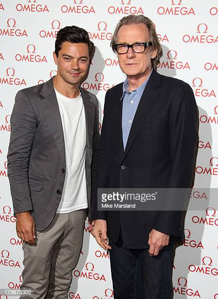 Dominic Cooper and Bill Nighy attend Omega's Summer Cocktail party on July 16 2013 in London England
