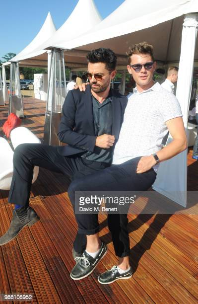 Dominic Cooper and Jeremy Irvine attend the Audi Polo Challenge at Coworth Park Polo Club on June 30 2018 in Ascot England
