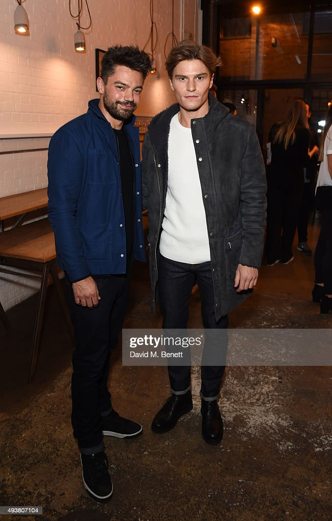 Dominic Cooper (L) and Oliver Cheshire attend Whistles Men 1st birthday celebrations at Protein Galleries on October 22, 2015 in London, England.