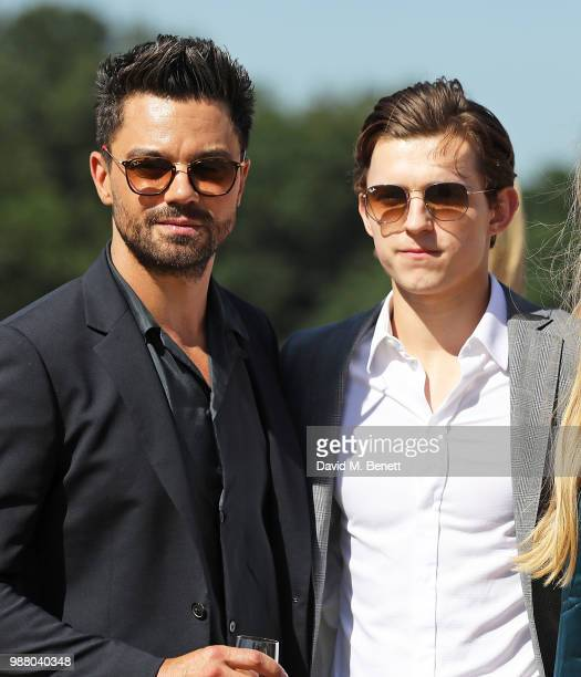 Dominic Cooper and Tom Holland attend the Audi Polo Challenge at Coworth Park Polo Club on June 30 2018 in Ascot England
