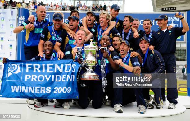 Dominic Cork and team captain Dimitri Mascarenhas hold the Friends Provident Trophy as Hampshire celebrate winning the Friends Provident Trophy Final...
