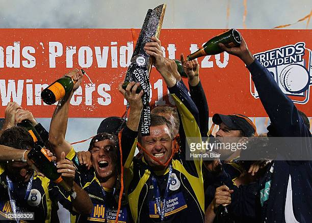 Dominic Cork of Hampshire celebrates with the trophy and team mates after the Friends Provident T20 Final between Hampshire Royals and Somerset at...