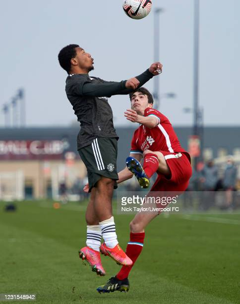 Dominic Corness of Liverpool and Dellon Hoogewerf of Manchester United in action during the U18 Premier League game between Liverpool and Manchester...