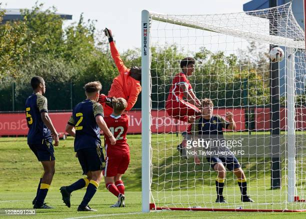 Dominic Corness of Liverpool scores Liverpool's fifth goal directly from a corner kick as Paul Cooper in the Stoke City goal tries to reach the the...
