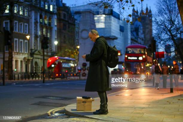 Dominic Cummings special adviser to UK prime minister Boris Johnson waits with a box after departing from number 10 Downing Street in London UK on...