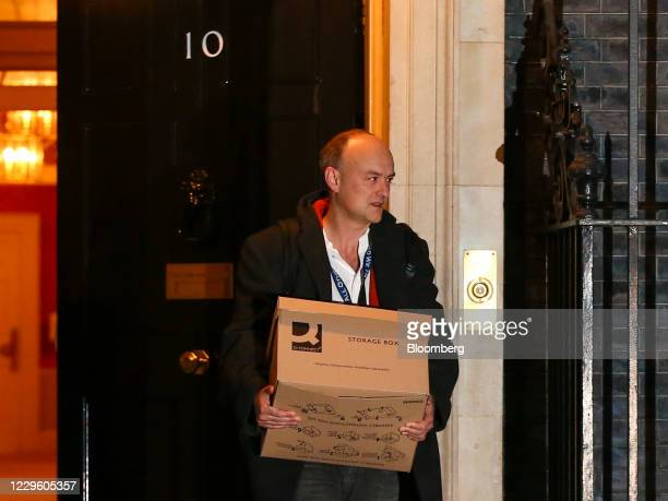 Dominic Cummings, special adviser to U.K. Prime minister Boris Johnson, carries a box as he departs from number 10 Downing Street in London, U.K., on...