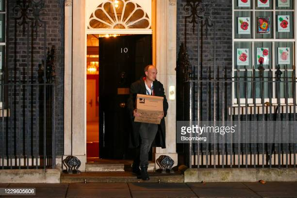 Dominic Cummings special adviser to UK prime minister Boris Johnson carries a box as he departs from number 10 Downing Street in London UK on Friday...