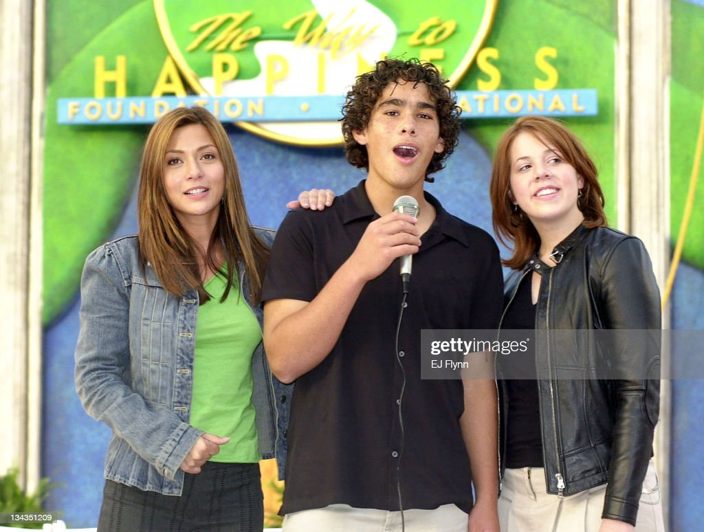 Dominic Domingo, 15, center, grandson of famed singer Placido Domingo, performs during his international singing debut with actress Lynsey Bartilson, right, of the WB's 'Grounded for Lfe,' and actress Marisol Nichols, left, at the grand opening of the international headquarters of The Way to Happpiness Foundation in Glendale, Calif., Saturday, Oct 4, 2003. The center is a base for international volunteer programs designed to restore dignity, honesty and trust building stronger families and safer neighborhoods.