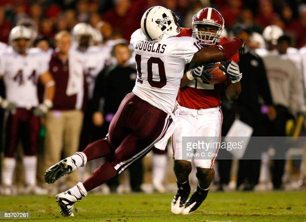 Dominic Douglas of the Mississippi State Bulldogs tackles running back Mark Ingram of the Alabama Crimson Tide during the game at BryantDenny Stadium...