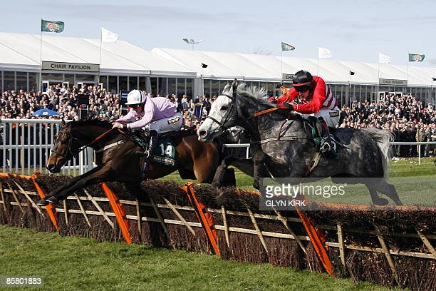 Dominic Elsworth riding Solwhit clears a barrier to beat Paul Townend on Five For Three winning the Aintree Hurdle on the third day of the Grand...