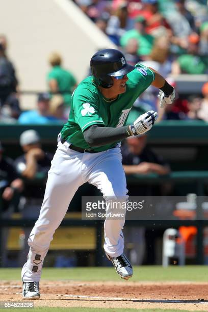 Dominic Ficociello of the Tigers hustles down to first base during the spring training game between the New York Yankees and the Detroit Tigers on...