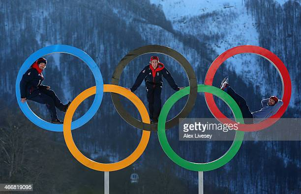 Dominic Harrington Ben Kilner and Billy Morgan of the Great Britain Snowboard Team pose for a portrait on the Olympic rings at the Athletes Village...