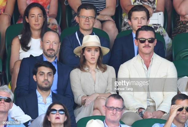 Dominic Holland and Tom Holland and John Vosler Emma Watson and Luke Evans attend the men's singles final on day thirteen of the Wimbledon Tennis...