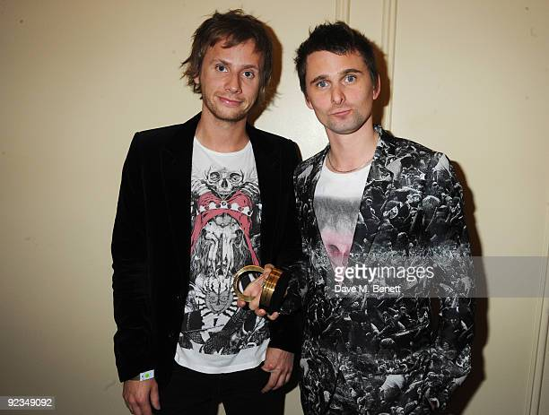 Dominic Howard and Matt Bellamy of Muse pose with the Best Act In The World Today Award at The Q Awards, at the Grosvenor House on October 26, 2009...