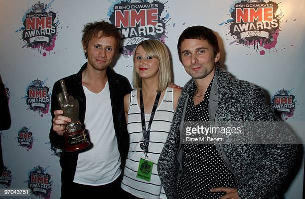 Dominic Howard and Matt Bellamy of Muse pose with their best British band award in front of the winners boards at the Shockwaves NME Awards 2010 held...