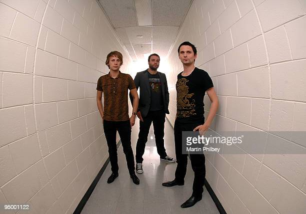 Dominic Howard Chris Wolstenholme and Matt Bellamy of Muse pose for a group portrait backstage at the Rod Laver Arena on November 15th 2007 in...