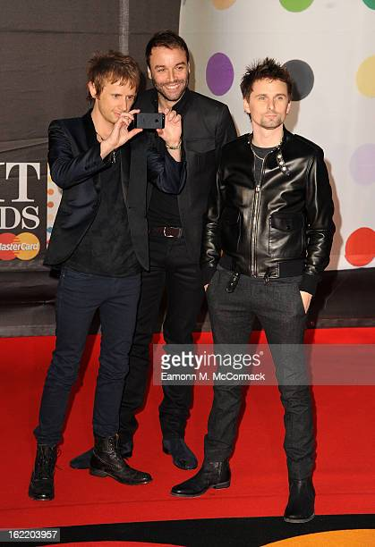 Dominic Howard, Chris Wolstenholme and Matthew Bellamy of Muse attend the Brit Awards 2013 at the 02 Arena on February 20, 2013 in London, England.