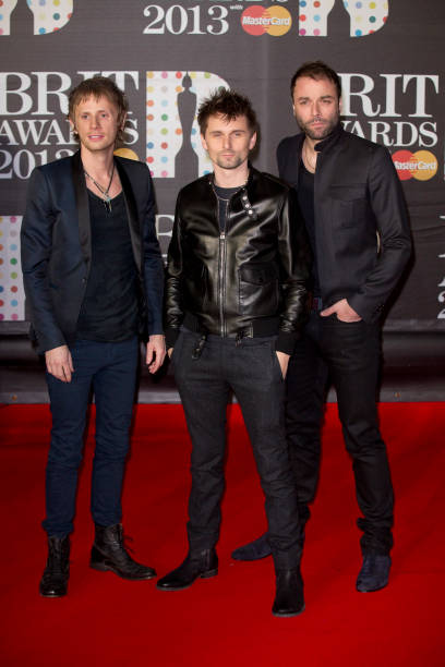 Brit awards 2013 red carpet arrivals photos and images getty images dominic howard matt bellamy and chris wolstenholme of muse attend the brit awards 2013 at voltagebd Image collections