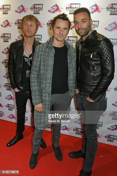 Dominic Howard Matt Bellamy and Chris Wolstenholme of Muse attend the VO5 NME Awards held at Brixton Academy on February 14 2018 in London England