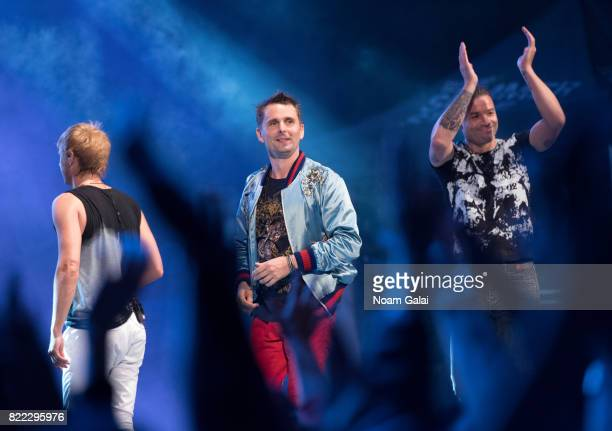 Dominic Howard Matt Bellamy and Chris Wolstenholme of Muse perform in concert at Central Park SummerStage on July 24 2017 in New York City