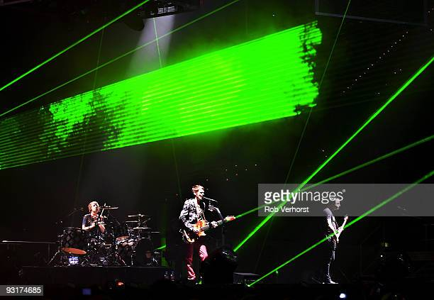 Dominic Howard Matt Bellamy and Chris Wolstenholme of Muse performs on stage at Ahoy on November 14 2009 in Rotterdam Netherlands