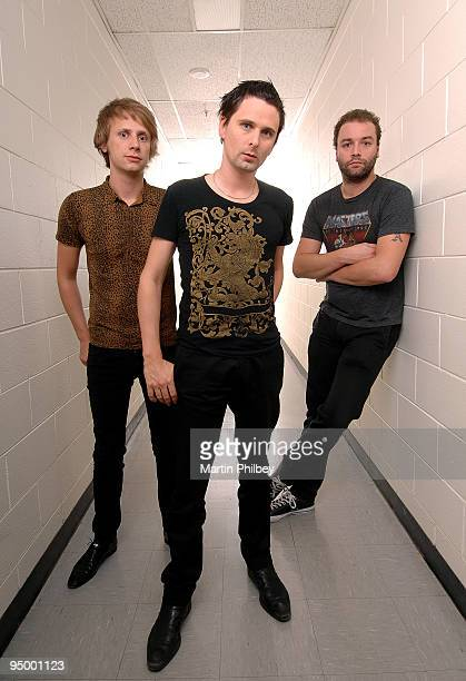 Dominic Howard Matt Bellamy and Chris Wolstenholme of Muse pose for a group portrait backstage at the Rod Laver Arena on November 15th 2007 in...