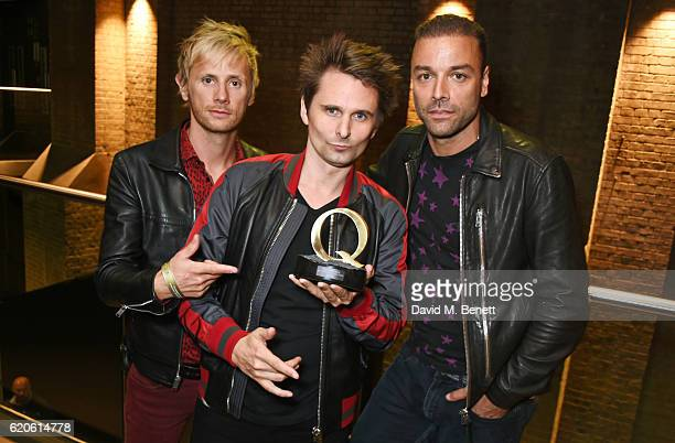 Dominic Howard Matt Bellamy and Chris Wolstenholme of Muse winners of the Best Act In The World Today award pose at The Stubhub Q Awards 2016 at The...
