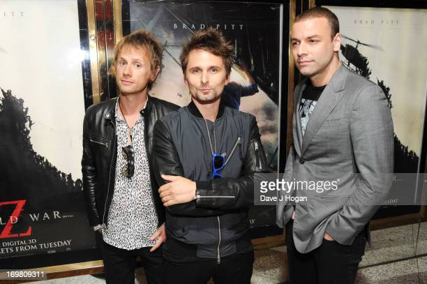 Dominic Howard Matt Bellamy and Christopher Wolstenholme of Muse attend world premiere of World War Z at the Empire Leicester Square on June 2 2013...