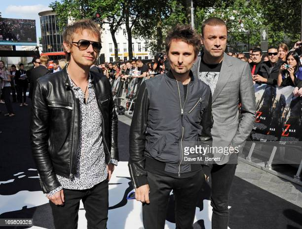 Dominic Howard Matt Bellamy and Christopher Wolstenholme of Muse attend the World Premiere of 'World War Z' at The Empire Cinema Leicester Square on...