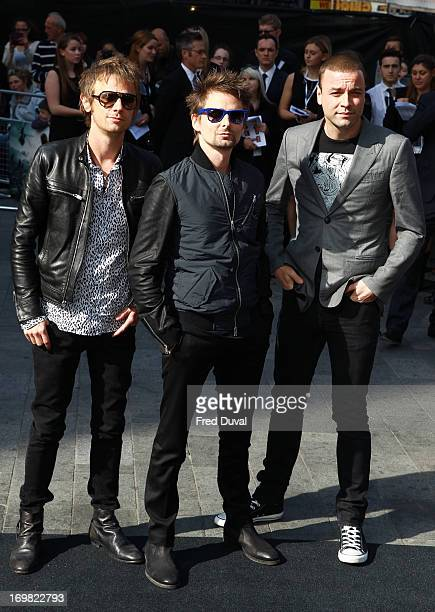 Dominic Howard, Matt Bellamy and Christopher Wolstenholme of Muse attend the World War Z world premiere at the Empire Leicester Square on June 2,...