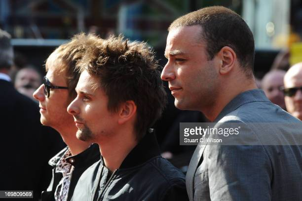 Dominic Howard, Matthew Bellamy and Chris Wolstenholme of Muse attend the World Premiere of 'World War Z' at The Empire Cinema on June 2, 2013 in...