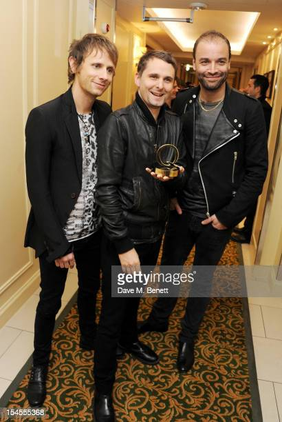 Dominic Howard Matthew Bellamy and Chris Wolstenholme of Muse pose in the press room at The Q Awards 2012 at the Grosvenor House Hotel on October 22...