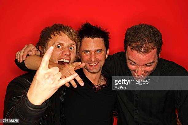 Dominic Howard, Matthew Bellamy and Chris Wolstenholme of Muse poses in the Studio during the MTV Europe Music Awards 2007 at the Olympiahalle on...