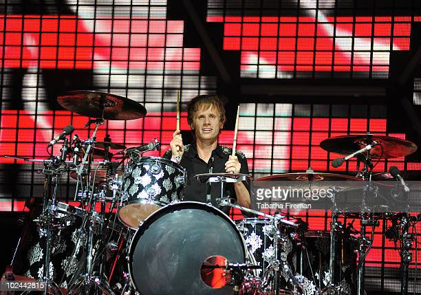 Dominic Howard of Muse headlines the Pyramid stage on the third day of Glastonbury Festival at Worthy Farm on June 26, 2010 in Glastonbury, England.