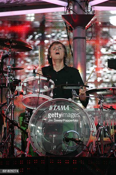 Dominic Howard of Muse performing on stage at Wembley Stadium in London on the 4th December 2007