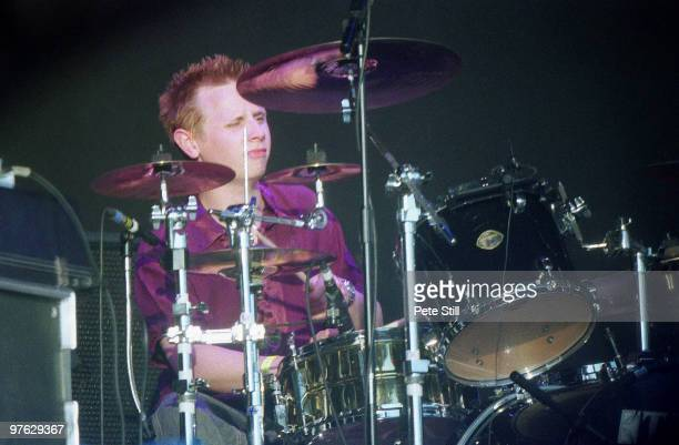 Dominic Howard of Muse performs on stage at the Glastonbury Festival on June 25th 2000 in Glastonbury England