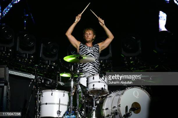 Dominic Howard of Muse performs on stage during day two of Formula 1 Singapore Grand Prix at Marina Bay Street Circuit on September 21, 2019 in...