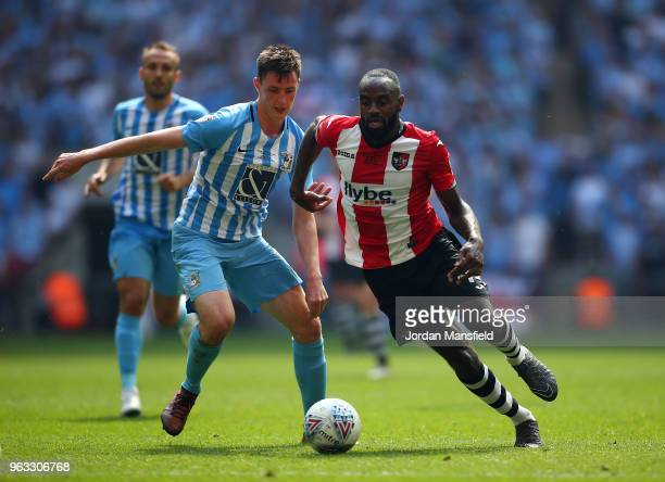 Dominic Hyam of Coventry City and Hiram Boateng of Exeter City in action during the Sky Bet League Two Play Off Final between Coventry City and...