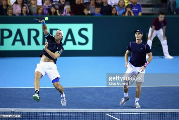 Dominic Inglot and Jamie Murray of Great Britain in action against Denis Istomin and Sanjar Fayziev of Uzbekistan during day two of the Davis Cup by...