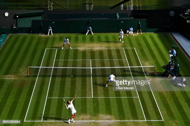 Dominic Inglot of Great Britain and Franko Skugor of Croatia compete against Robin Haase of the Netherlands and Robert Lindstedt of Sweden during...