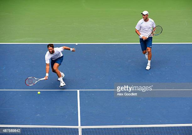 Dominic Inglot of Great Britain and Robert Lindstedt of Sweden play against Nicolas Mahut of France and PierreHugues Herbert of France during their...