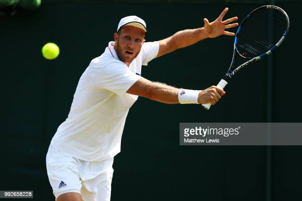 Dominic Inglot of Great Britain returns a shot during his Men's Doubles second round match against Marcelo Demoliner of Brazil and Santiago Gonzalez...